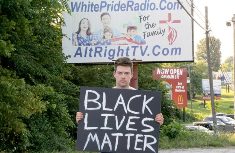 He held up a Black Lives Matter sign not far from KKK headquarters and recorded the reactions