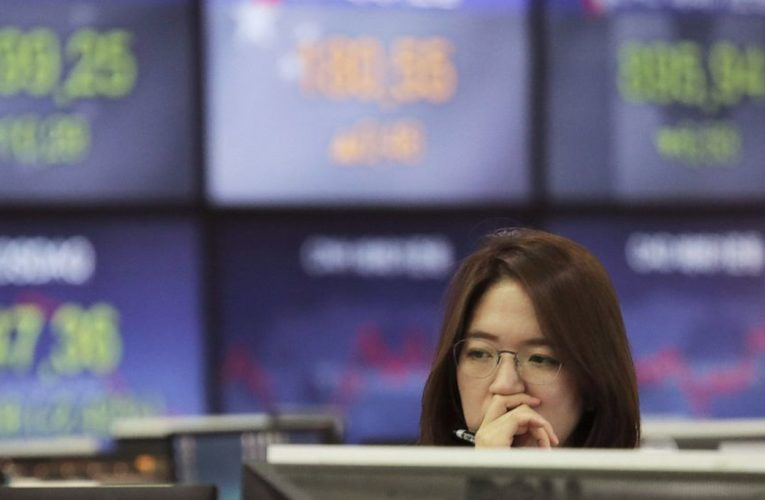 Asian shares mostly higher on stimulus moves, jobs data